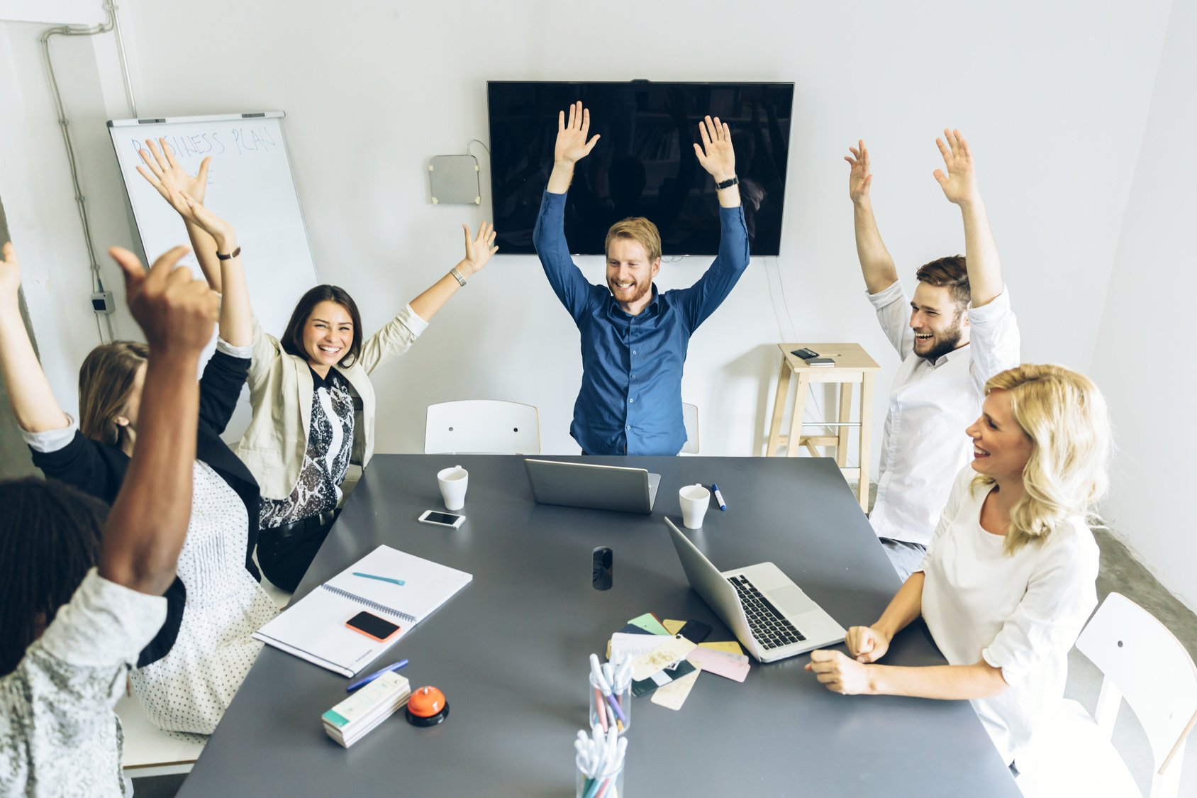 Group of happy coworkers content as goal is achieved