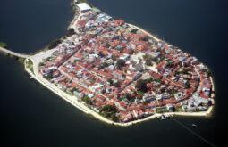 Cidade de Flores base para Tikan